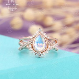 Shop Moonstone Engagement Rings! Vintage moonstone engagement ring set , Rose gold art deco ring set wedding ring set, Pear shaped Diamond/ Moissanite ring set, anniversary | Natural genuine Moonstone rings, simple unique alternative gemstone engagement rings. #rings #jewelry #bridal #wedding #jewelryaccessories #engagementrings #weddingideas #affiliate #ad