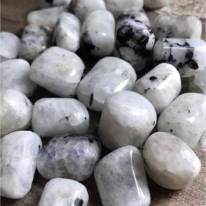 Shop Tumbled Moonstone Crystals & Pocket Stones! Rainbow Moonstone | Natural genuine stones & crystals in various shapes & sizes. Buy raw cut, tumbled, or polished gemstones for making jewelry or crystal healing energy vibration raising reiki stones. #crystals #gemstones #crystalhealing #crystalsandgemstones #energyhealing #affiliate #ad
