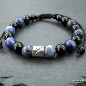 Shop Obsidian Bracelets! Sagittarius Bracelet, Sodalite black Obsidian gemstones, Energy wristband, Zodiac gift for him or her, Men Jewelry | Natural genuine Obsidian bracelets. Buy crystal jewelry, handmade handcrafted artisan jewelry for women.  Unique handmade gift ideas. #jewelry #beadedbracelets #beadedjewelry #gift #shopping #handmadejewelry #fashion #style #product #bracelets #affiliate #ad