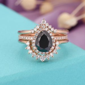 Shop Onyx Jewelry! Vintage Black Onyx engagement ring set art deco Rose gold ring Women 14k Pear shaped Halo Moissanite Curved Wedding band Anniversary gifts | Natural genuine Onyx jewelry. Buy handcrafted artisan wedding jewelry.  Unique handmade bridal jewelry gift ideas. #jewelry #beadedjewelry #gift #crystaljewelry #shopping #handmadejewelry #wedding #bridal #jewelry #affiliate #ad