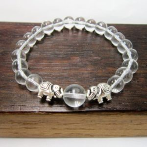 Shop Quartz Crystal Bracelets! Clear Quartz Elephant Bracelet Clear Quartz Chakra Elephant Bracelet Healing Clear Quartz Bracelet Good Luck Bracelet Clear Quartz Elephant | Natural genuine Quartz bracelets. Buy crystal jewelry, handmade handcrafted artisan jewelry for women.  Unique handmade gift ideas. #jewelry #beadedbracelets #beadedjewelry #gift #shopping #handmadejewelry #fashion #style #product #bracelets #affiliate #ad