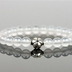 Shop Quartz Crystal Bracelets! Milky Quartz Genuine Gemstone bracelet with a Sterling Silver Flower, White Gemstone Bracelet, Handmade Jewelry | Natural genuine Quartz bracelets. Buy crystal jewelry, handmade handcrafted artisan jewelry for women.  Unique handmade gift ideas. #jewelry #beadedbracelets #beadedjewelry #gift #shopping #handmadejewelry #fashion #style #product #bracelets #affiliate #ad