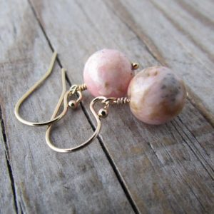Shop Rhodochrosite Earrings! Rhodochrosite Earrings, small and simple, pink rhodochrosite dangles, silver earrings | Natural genuine Rhodochrosite earrings. Buy crystal jewelry, handmade handcrafted artisan jewelry for women.  Unique handmade gift ideas. #jewelry #beadedearrings #beadedjewelry #gift #shopping #handmadejewelry #fashion #style #product #earrings #affiliate #ad