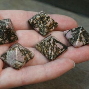 Shop Rhodonite Stones & Crystals! Rhodonite Stone Pyramid Figurine C53 | Natural genuine stones & crystals in various shapes & sizes. Buy raw cut, tumbled, or polished gemstones for making jewelry or crystal healing energy vibration raising reiki stones. #crystals #gemstones #crystalhealing #crystalsandgemstones #energyhealing #affiliate #ad