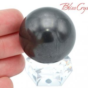 Shop Shungite Stones & Crystals! 1.4 inch Shungite Sphere + Stand Healing Crystal and Stone #SS58 | Natural genuine stones & crystals in various shapes & sizes. Buy raw cut, tumbled, or polished gemstones for making jewelry or crystal healing energy vibration raising reiki stones. #crystals #gemstones #crystalhealing #crystalsandgemstones #energyhealing #affiliate #ad
