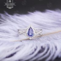 Tanzanite Engagement Ring Set White Gold Women, Vintage Wedding Ring, Pear Shaped, curved Diamond / Moissanite Band, anniversary Gifts For Her | Natural genuine Gemstone jewelry. Buy handcrafted artisan wedding jewelry.  Unique handmade bridal jewelry gift ideas. #jewelry #beadedjewelry #gift #crystaljewelry #shopping #handmadejewelry #wedding #bridal #jewelry #affiliate #ad