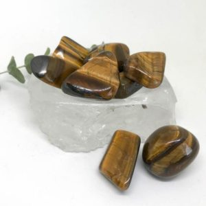 Shop Tumbled Tiger Eye Crystals & Pocket Stones! Tumbled Golden Tigers Eye – A Stone For Courage And Strength | Natural genuine stones & crystals in various shapes & sizes. Buy raw cut, tumbled, or polished gemstones for making jewelry or crystal healing energy vibration raising reiki stones. #crystals #gemstones #crystalhealing #crystalsandgemstones #energyhealing #affiliate #ad