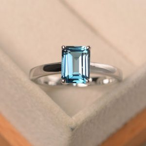 Shop Topaz Engagement Rings! London blue topaz ring, blue gemstone ring, solitaire ring, 4-prong ring, engagement ring for women | Natural genuine Topaz rings, simple unique alternative gemstone engagement rings. #rings #jewelry #bridal #wedding #jewelryaccessories #engagementrings #weddingideas #affiliate #ad