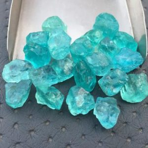 Shop Apatite Stones & Crystals! 50 Pieces Raw 8-10 Mm Raw Blue Apatite Gemstone, natural Neon Blue Apatite Raw Stone, apatite Rough Gemstone, apatite Raw Loose Gemstone Rough | Natural genuine stones & crystals in various shapes & sizes. Buy raw cut, tumbled, or polished gemstones for making jewelry or crystal healing energy vibration raising reiki stones. #crystals #gemstones #crystalhealing #crystalsandgemstones #energyhealing #affiliate #ad
