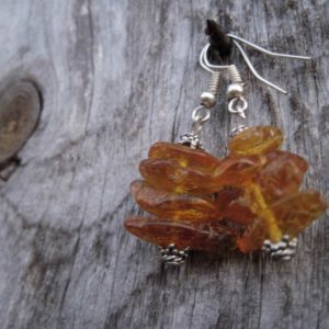 Unpolished Baltic Amber Earrings Dangle Honey Rough Stone Jewelry Raw Natural Eco Organic Sunny Zen | Natural genuine Amber earrings. Buy crystal jewelry, handmade handcrafted artisan jewelry for women.  Unique handmade gift ideas. #jewelry #beadedearrings #beadedjewelry #gift #shopping #handmadejewelry #fashion #style #product #earrings #affiliate #ad