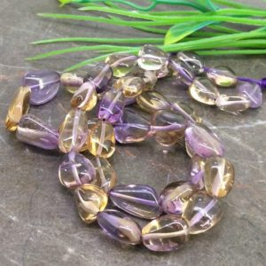 Shop Ametrine Beads! Natural Ametrine 9-17mm Smooth Nuggets Briolette Beads / Approx 40 pieces on 17 Inch long strand / JBC-ET-135266 | Natural genuine beads Ametrine beads for beading and jewelry making.  #jewelry #beads #beadedjewelry #diyjewelry #jewelrymaking #beadstore #beading #affiliate #ad