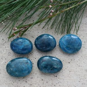 Shop Tumbled Apatite Crystals & Pocket Stones! One Blue Apatite Mini Palm Stone / Tumbled From Madagascar For Healing Or Enjoyment | Natural genuine stones & crystals in various shapes & sizes. Buy raw cut, tumbled, or polished gemstones for making jewelry or crystal healing energy vibration raising reiki stones. #crystals #gemstones #crystalhealing #crystalsandgemstones #energyhealing #affiliate #ad