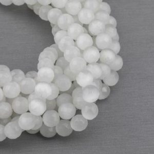 Shop Selenite Beads! Cats Eye – Selenite Quartz- High Quality In Faceted Round, 4mm, 6mm, 8mm, 10mm, 12mm- Full Strand 15.5 Inches Long- White | Natural genuine round Selenite beads for beading and jewelry making.  #jewelry #beads #beadedjewelry #diyjewelry #jewelrymaking #beadstore #beading #affiliate #ad