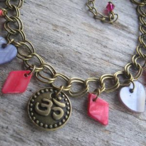 Om Charm Bracelet, Mother of Pearl Shell Bracelet, Buddhist Bracelet, BRONZE, Boho, Purple Hearts, Magenta Red Diamonds, Yoga Jewelry | Natural genuine Gemstone bracelets. Buy crystal jewelry, handmade handcrafted artisan jewelry for women.  Unique handmade gift ideas. #jewelry #beadedbracelets #beadedjewelry #gift #shopping #handmadejewelry #fashion #style #product #bracelets #affiliate #ad