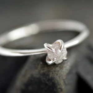 Shop Raw Diamond Engagement Rings! Rough Diamond Engagement Ring. Raw Diamond Ring. White Diamond Ring. Raw White Diamond Ring. Rose Gold Diamond Engagement Ring. | Natural genuine Diamond rings, simple unique alternative gemstone engagement rings. #rings #jewelry #bridal #wedding #jewelryaccessories #engagementrings #weddingideas #affiliate #ad