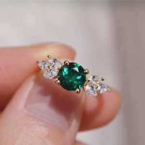 Shop Emerald Engagement Rings! Solid 14K Gold Emerald Ring/ Lab Created Emearld Engagement Ring/ May Birthstone Ring | Natural genuine Emerald rings, simple unique alternative gemstone engagement rings. #rings #jewelry #bridal #wedding #jewelryaccessories #engagementrings #weddingideas #affiliate #ad