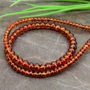 Shop Garnet Rondelle Beads! Natural Hessonite Garnet 3-4.5mm Smooth Rondelle Gemstone Beads / Approx 114 pieces on 11 Inch long strand / JBC-ET-153846 | Natural genuine rondelle Garnet beads for beading and jewelry making.  #jewelry #beads #beadedjewelry #diyjewelry #jewelrymaking #beadstore #beading #affiliate #ad