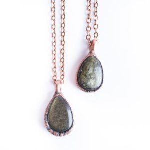 Shop Healing Gemstone & Crystal Pendants! Gold sheen obsidian necklace | Raw obsidian jewelry | Gold sheen obsidian | Obsidian necklace | Obsidian pendant | Black obsidian necklace | Natural genuine Gemstone pendants. Buy crystal jewelry, handmade handcrafted artisan jewelry for women.  Unique handmade gift ideas. #jewelry #beadedpendants #beadedjewelry #gift #shopping #handmadejewelry #fashion #style #product #pendants #affiliate #ad
