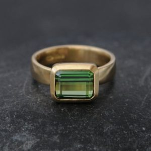 Green Tourmaline Ring Green Gem Engagement Ring Solitaire Tourmaline Ring Emerald Cut Tourmaline in 18k Gold  Made to Order | Natural genuine Gemstone rings, simple unique alternative gemstone engagement rings. #rings #jewelry #bridal #wedding #jewelryaccessories #engagementrings #weddingideas #affiliate #ad