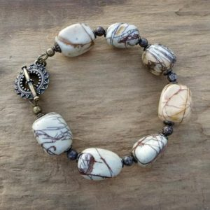 Shop Jasper Bracelets! Chunky White Jasper Bracelet, Rustic Bohemian Picasso Jasper Stone Pebble Statement Bracelet In Brown And White | Natural genuine Jasper bracelets. Buy crystal jewelry, handmade handcrafted artisan jewelry for women.  Unique handmade gift ideas. #jewelry #beadedbracelets #beadedjewelry #gift #shopping #handmadejewelry #fashion #style #product #bracelets #affiliate #ad