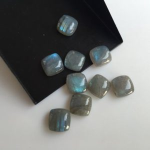 Shop Labradorite Cabochons! 25 Pieces 10x10mm Each Labradorite Square Shaped Black flashes of blue Loose Cabochons SKU-L7 | Natural genuine stones & crystals in various shapes & sizes. Buy raw cut, tumbled, or polished gemstones for making jewelry or crystal healing energy vibration raising reiki stones. #crystals #gemstones #crystalhealing #crystalsandgemstones #energyhealing #affiliate #ad
