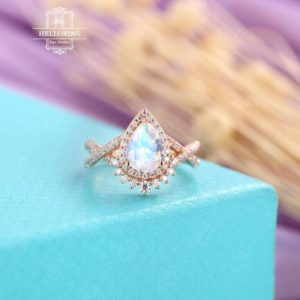 Shop Moonstone Rings! Pear Shaped Moonstone Engagement Ring, Rose Gold, Halo Diamond / Moissanite Band For Women, delicate Ring, Twisted Band Vintage Jewelry | Natural genuine Moonstone rings, simple unique alternative gemstone engagement rings. #rings #jewelry #bridal #wedding #jewelryaccessories #engagementrings #weddingideas #affiliate #ad