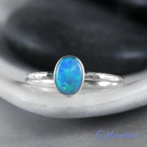Shop Opal Rings! Dainty Oval Blue Opal Promise Ring, Sterling Silver Blue Opal Ring, Blue Opal Ring Silver | Moonkist Designs | Natural genuine Opal rings, simple unique handcrafted gemstone rings. #rings #jewelry #shopping #gift #handmade #fashion #style #affiliate #ad