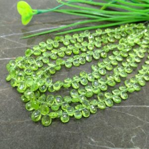 Shop Peridot Bead Shapes! Natural Peridot 6-7mm Faceted Pear Briolette Beads / Approx 85 pieces on 8 Inch long strand / JBC-ET-BPRI023 | Natural genuine other-shape Peridot beads for beading and jewelry making.  #jewelry #beads #beadedjewelry #diyjewelry #jewelrymaking #beadstore #beading #affiliate #ad