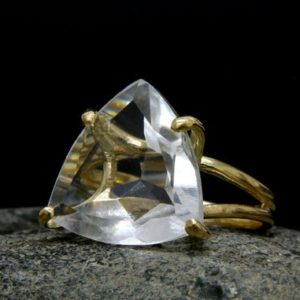 Shop Quartz Crystal Rings! Trillion Quartz Ring, wedding Ring, trillion Ring, triangle Ring, gold Ring, statement Ring, gold Cocktail Ring | Natural genuine Quartz rings, simple unique alternative gemstone engagement rings. #rings #jewelry #bridal #wedding #jewelryaccessories #engagementrings #weddingideas #affiliate #ad