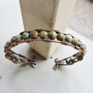 Shop Rainforest Jasper Bracelets! Copper Wire Wrapped Cuff Bracelet with Green Rhyolite | Natural genuine Rainforest Jasper bracelets. Buy crystal jewelry, handmade handcrafted artisan jewelry for women.  Unique handmade gift ideas. #jewelry #beadedbracelets #beadedjewelry #gift #shopping #handmadejewelry #fashion #style #product #bracelets #affiliate #ad