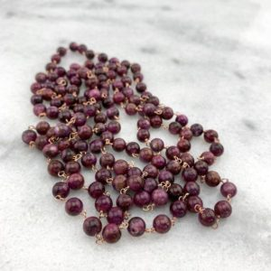 Shop Ruby Round Beads! Red Ruby Precious Beads Wire Wrapped w/ 14k Rose Gold Filled Wire Long Statement Necklace-July Birthstone/15th Anniversary | Natural genuine round Ruby beads for beading and jewelry making.  #jewelry #beads #beadedjewelry #diyjewelry #jewelrymaking #beadstore #beading #affiliate #ad