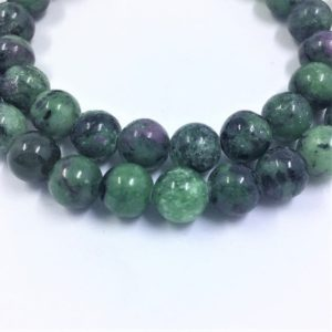 Shop Ruby Zoisite Round Beads! Ruby in Zoisite Gemstone Beads. 8mm round beads on 15 inch strand. Full strand of AA/AAA Grade beads, about 48 per strand. Green Black Pink | Natural genuine round Ruby Zoisite beads for beading and jewelry making.  #jewelry #beads #beadedjewelry #diyjewelry #jewelrymaking #beadstore #beading #affiliate #ad