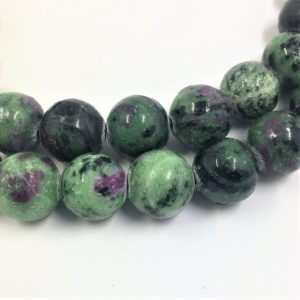 Shop Ruby Zoisite Round Beads! Ruby in Zoisite Gemstone Beads. 12mm round beads on 15 inch strand. Full strand of high quality beads, about 32 per strand. Green Black Pink | Natural genuine round Ruby Zoisite beads for beading and jewelry making.  #jewelry #beads #beadedjewelry #diyjewelry #jewelrymaking #beadstore #beading #affiliate #ad