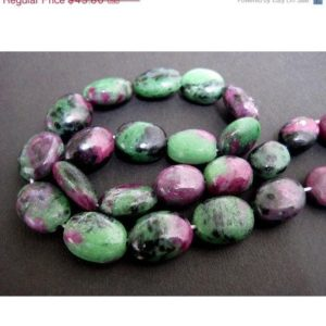Shop Ruby Zoisite Stones & Crystals! Ruby Zoisite Tumbles – 20mm Approx Plain Oval Tumbles – 13 Inch Strand – 21 Pieces | Natural genuine stones & crystals in various shapes & sizes. Buy raw cut, tumbled, or polished gemstones for making jewelry or crystal healing energy vibration raising reiki stones. #crystals #gemstones #crystalhealing #crystalsandgemstones #energyhealing #affiliate #ad