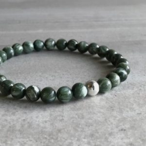 Shop Seraphinite Bracelets! Seraphinite Bracelet | Men's, Women's Green Beaded Bracelet | Gold Or Silver Seraphinite Jewelry | Natural Crystal Beads | Natural genuine Seraphinite bracelets. Buy crystal jewelry, handmade handcrafted artisan jewelry for women.  Unique handmade gift ideas. #jewelry #beadedbracelets #beadedjewelry #gift #shopping #handmadejewelry #fashion #style #product #bracelets #affiliate #ad