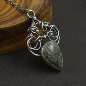 Shop Seraphinite Pendants! Green Seraphinite Necklace, Wire Wrapped Silver Pendant, Elven Jewelry | Natural genuine Seraphinite pendants. Buy crystal jewelry, handmade handcrafted artisan jewelry for women.  Unique handmade gift ideas. #jewelry #beadedpendants #beadedjewelry #gift #shopping #handmadejewelry #fashion #style #product #pendants #affiliate #ad