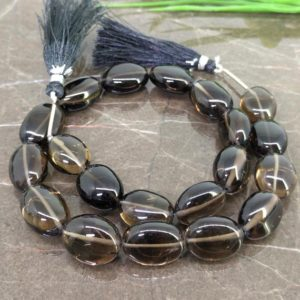 Shop Smoky Quartz Bead Shapes! Natural Smoky Quartz 15-18mm Smooth Oval Gemstone Beads / Approx 20 Pieces On 16 Inch Long Strand / Jbc-et-148667 | Natural genuine other-shape Smoky Quartz beads for beading and jewelry making.  #jewelry #beads #beadedjewelry #diyjewelry #jewelrymaking #beadstore #beading #affiliate #ad