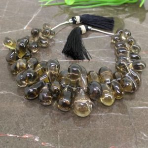 Shop Smoky Quartz Bead Shapes! Natural Smoky Quartz 10-21mm Smooth Drops Briolette Beads / Approx 56 pieces on 8 Inch long strand / JBC-ET-148764 | Natural genuine other-shape Smoky Quartz beads for beading and jewelry making.  #jewelry #beads #beadedjewelry #diyjewelry #jewelrymaking #beadstore #beading #affiliate #ad
