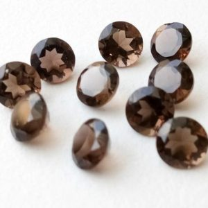 Shop Smoky Quartz Shapes! 10 Pcs Smoky Quartz Solitaire Cut Stones, Natural Smoky Quartz Round Cut Loose Gemstone For Jewelry, Brown Stone (10mm To 16mm Options) | Natural genuine stones & crystals in various shapes & sizes. Buy raw cut, tumbled, or polished gemstones for making jewelry or crystal healing energy vibration raising reiki stones. #crystals #gemstones #crystalhealing #crystalsandgemstones #energyhealing #affiliate #ad
