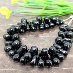 Shop Spinel Bead Shapes! Natural Black Spinel 11-13mm Smooth Drops Briolette Beads / Approx 67 pieces on 9 Inch long strand / JBC-ET-148802 | Natural genuine other-shape Spinel beads for beading and jewelry making.  #jewelry #beads #beadedjewelry #diyjewelry #jewelrymaking #beadstore #beading #affiliate #ad