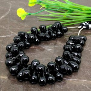 Natural Black Spinel 12-14mm Smooth Pear Briolette Beads / Approx 63 Pieces On 9 Inch Long Strand / Jbc-et-148801 | Natural genuine other-shape Spinel beads for beading and jewelry making.  #jewelry #beads #beadedjewelry #diyjewelry #jewelrymaking #beadstore #beading #affiliate #ad