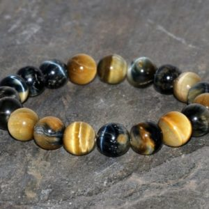 Shop Tiger Eye Bracelets! Chunky Golden Blue Tigers Eye Bracelet 10mm Blue Gold Tigers Eye Gemstone Bracelet Blue Golden Tiger's Eye Beaded Bracelet Stacking Bracelet | Natural genuine Tiger Eye bracelets. Buy crystal jewelry, handmade handcrafted artisan jewelry for women.  Unique handmade gift ideas. #jewelry #beadedbracelets #beadedjewelry #gift #shopping #handmadejewelry #fashion #style #product #bracelets #affiliate #ad