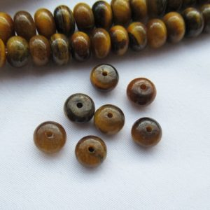 Shop Tiger Eye Rondelle Beads! Yellow Tiger Eye Rondelle Bead 4x6mm Natural Tiger Eye Bead Gemstone Strands g076 | Natural genuine rondelle Tiger Eye beads for beading and jewelry making.  #jewelry #beads #beadedjewelry #diyjewelry #jewelrymaking #beadstore #beading #affiliate #ad