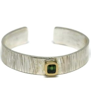 Shop Green Tourmaline Bracelets! 14K Green Tourmaline Bracelet, Silver Bamboo Cuff With Gold Bezel Set Green Gemstone.   Artisan Handmade by Sheri Beryl | Natural genuine Green Tourmaline bracelets. Buy crystal jewelry, handmade handcrafted artisan jewelry for women.  Unique handmade gift ideas. #jewelry #beadedbracelets #beadedjewelry #gift #shopping #handmadejewelry #fashion #style #product #bracelets #affiliate #ad