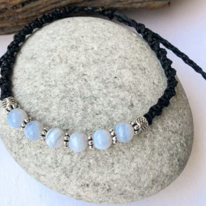 Shop Blue Lace Agate Bracelets! Blue lace agate macrame bracelet, Round Blue stones, Silver black & Blue, Adjustable Blue agate macrame bracelet, Natural stones jewelry | Natural genuine Blue Lace Agate bracelets. Buy crystal jewelry, handmade handcrafted artisan jewelry for women.  Unique handmade gift ideas. #jewelry #beadedbracelets #beadedjewelry #gift #shopping #handmadejewelry #fashion #style #product #bracelets #affiliate #ad
