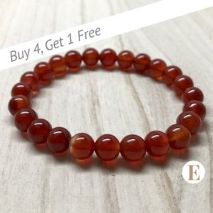 Shop Carnelian Jewelry! Carnelian Bracelet | 8 mm Beads | Carnelian Beads | Stretch Bracelet | Healing Crystal Bracelet | Buy 4 Get 1 FREE! | Natural genuine Carnelian jewelry. Buy crystal jewelry, handmade handcrafted artisan jewelry for women.  Unique handmade gift ideas. #jewelry #beadedjewelry #beadedjewelry #gift #shopping #handmadejewelry #fashion #style #product #jewelry #affiliate #ad