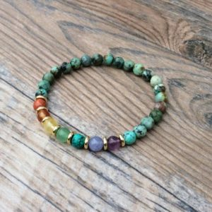 Shop Chakra Bracelets! Chakra bracelet with African Turquoise | Shop jewelry making and beading supplies, tools & findings for DIY jewelry making and crafts. #jewelrymaking #diyjewelry #jewelrycrafts #jewelrysupplies #beading #affiliate #ad
