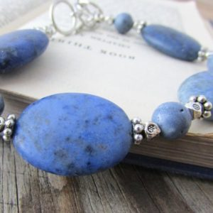 Shop Dumortierite Bracelets! Sunset Dumortierite Bracelet, matte finish, adjustable, dumortierite and coral bracelet | Natural genuine Dumortierite bracelets. Buy crystal jewelry, handmade handcrafted artisan jewelry for women.  Unique handmade gift ideas. #jewelry #beadedbracelets #beadedjewelry #gift #shopping #handmadejewelry #fashion #style #product #bracelets #affiliate #ad