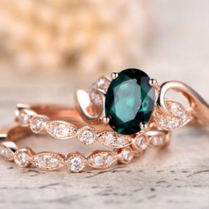 Emerald Engagement Ring Set Oval Cut Emerald Ring Set and Two Milgrain Wedding Bands Bridal Wedding Ring Set 14k Rose Gold | Natural genuine Gemstone rings, simple unique alternative gemstone engagement rings. #rings #jewelry #bridal #wedding #jewelryaccessories #engagementrings #weddingideas #affiliate #ad