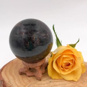 Shop Garnet Shapes! Almandine Garnet Sphere  – A Stone for Gentle Grounding | Natural genuine stones & crystals in various shapes & sizes. Buy raw cut, tumbled, or polished gemstones for making jewelry or crystal healing energy vibration raising reiki stones. #crystals #gemstones #crystalhealing #crystalsandgemstones #energyhealing #affiliate #ad